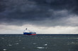 Dark cloudy stormy sky with ship and waves in the sea. - 79561000