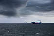 Dark cloudy stormy sky with ship and waves in the sea. - 79561005