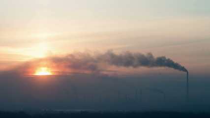 Steel works at sunrise. Time lapse.