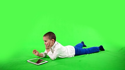 Child playing on a tablet greenscreen