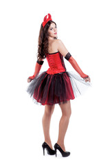 Playful young woman is wearing a sexy devil costume