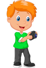 Little boy holding camera