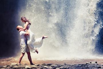 couple travel near the waterfall