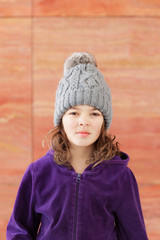 little girl  with wool hat, very serious