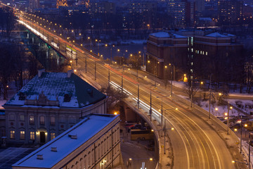Movement of cars on night street in Warsaw in winter