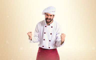 Lucky chef over isolated white background