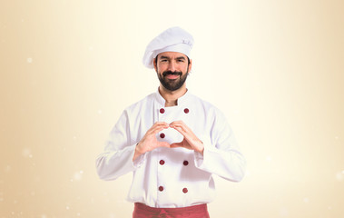 Chef making a heart with her hands