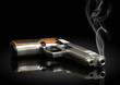 Leinwanddruck Bild - handgun on black background with smoke
