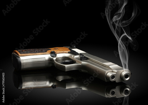 handgun on black background with smoke - 79565403