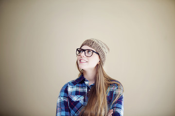 Happy young woman thinking