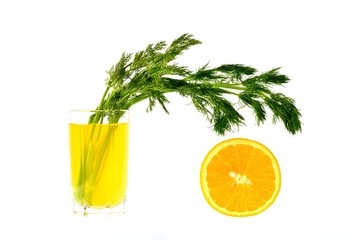 Lemon juice with a bunch of dill and half orange