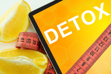 Tablet with word detox and measuring tape