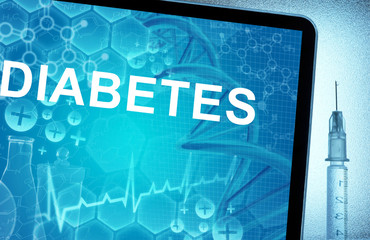 the words diabetes on a tablet with syringe