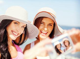 girls taking self portrait on the beach