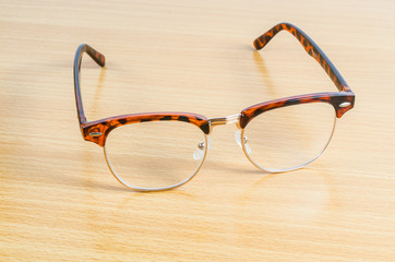 eyeglasses isolated on wooden background