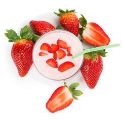 strawberry smoothie in a glass and berries , top view