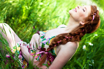 Beautiful pregnant woman relaxing in forest