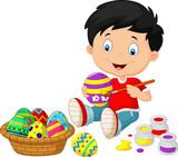 Little boy painting an Easter egg