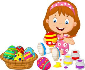 Little girl painting an Easter egg