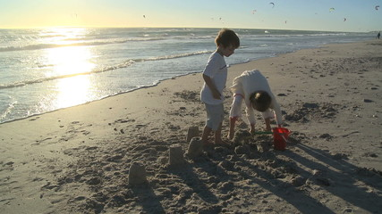 LS OF CHILDREN MAKING SANDCASTLES
