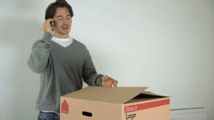 MS ZO OF A MAN OPENING A BOX
