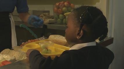 Woman serving schoolgirl