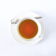 The white cup tea on the white background