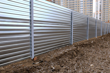 A fence made of metal professional flooring
