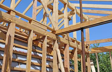 Installation of wooden beams at construction