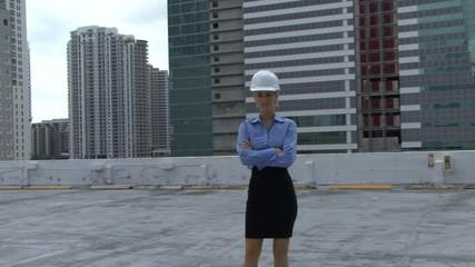 Pan portrait of female on a construction site
