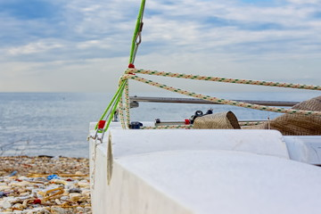 Catamaran left ashore and stranded in winter on the beach
