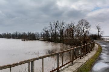 Flood - a natural phenomenon. Spilled lake submerged fields.