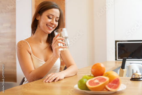 Young Woman with glass of Water. Healthy Lifestyle