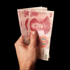 Modern Chinese 100 yuan renminbi banknotes in male hand