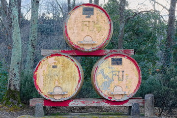 Ancient and large barrels ornament on road in Pisa countryside