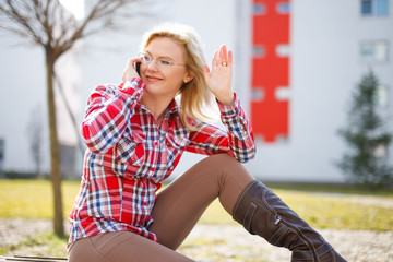Young  businesswoman call and wave with hand