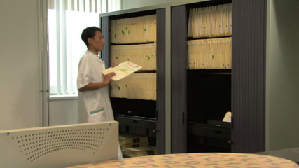 LS MS PAN ZI OF A DOCTOR READING A FILE