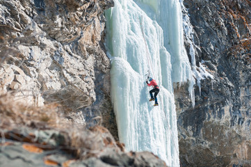 climber ascends the vertical icefall