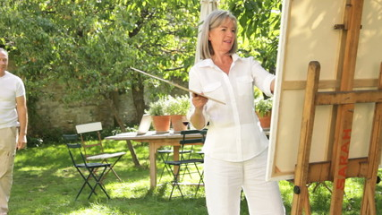 Mature couple in garden painting