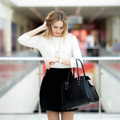 Young business woman late for meeting