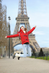 Young woman near the Eiffel tower, in Paris, France