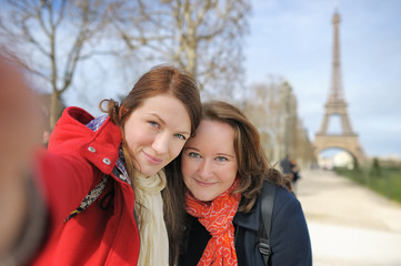 Two woman taking selfie near the Eiffel tower