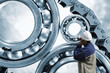 engineer, worker with giant ball-bearings and chains