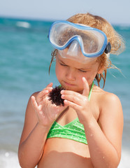 Girl with sea hedgehog