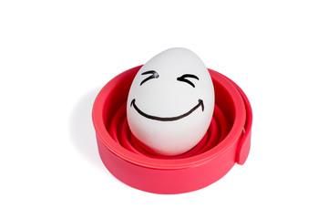 Funny egg on red base