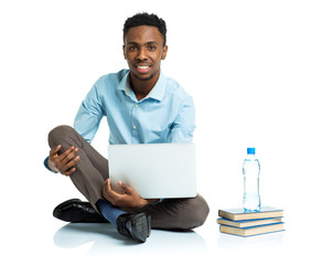 African american college student sitting with laptop on white ba