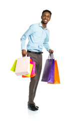 Happy african american man with shopping bags on white