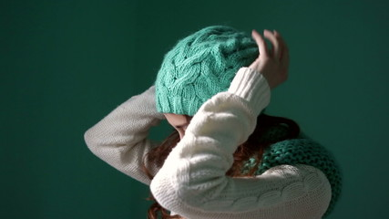 Beautiful girl dresses turquoise knitted hat