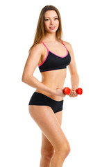 Beautiful athletic woman with dumbbells doing sport exercise, is