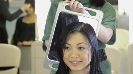 MS R/F Woman having hair cut in hair salon